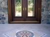 classic stone medallion, home entryway